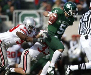 EAST LANSING, MI - OCTOBER 14:  Drew Stanton #5 of the Michigan State Spartans tries to escape the tackle of Jay Richardson #99 and James Laurinaitis #33 of the Ohio State Buckeys during first quarter action on October 14, 2006 at Spartan Stadium in East