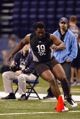 INDIANAPOLIS, IN - FEBRUARY 21:  Offensive lineman Xavier Fulton of Illinois runs in practice drills during the NFL Scouting Combine presented by Under Armour at Lucas Oil Stadium on February 21, 2009 in Indianapolis, Indiana. (Photo by Scott Boehm/Getty