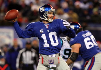 EAST RUTHERFORD, NJ - DECEMBER 21:  Eli Manning #10 of the New York Giants throws a pass against the Carolina Panthers on December 21, 2008 at Giants Stadium in East Rutherford, New Jersey.  (Photo by Jim McIsaac/Getty Images)