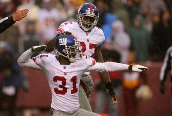 LANDOVER, MD - NOVEMBER 30:  Aaron Ross #31 of the New York Giants celebrates after an interception with teammate James Butler #37 against the Washington Redskins during their game at FedEx Field on November 30, 2008 in Landover, Maryland.  (Photo by Stre