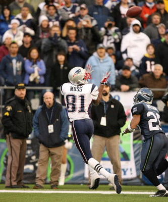SEATTLE - DECEMBER 07:  Wide receiver Randy Moss #81 of the New England Patriots hauls in a 33 yard catch in the fourth quarter against Josh Wilson #26 of the Seattle Seahawks on December 7, 2008 at Qwest Field in Seattle, Washington. The Patriots defeate