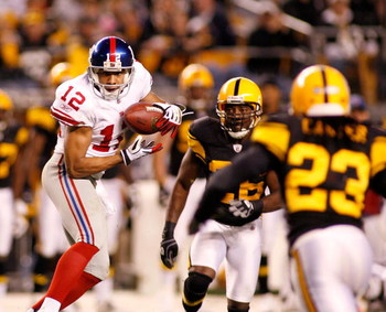 PITTSBURGH - OCTOBER 26: Steve Smith #12 of the New York Giants makes a catch between Deshea Townsend #26 and Tyrone Carter #23 of the Pittsburgh Steelers on October 26, 2008 at Heinz Field in Pittsburgh, Pennsylvania. The Giants won 21-14. (Photo by Rick