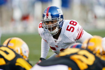 PITTSBURGH - OCTOBER 26:  Antono Pierce #58 of the New York Giants gets ready at the line of scrimmage during the game against the Pittsburgh Steelers at Heinz Field on October 26, 2008 in Pittsburgh, Pennsylvania. (Photo by: Rick Stewart/Getty Images)