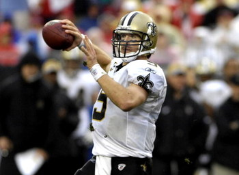 TAMPA, FL - NOVEMBER 30: Quarterback Drew Brees #9 of the New Orleans Saints sets to pass against the Tampa Bay Buccaneers at Raymond James Stadium on November 30, 2008 in Tampa, Florida.  (Photo by Al Messerschmidt/Getty Images)