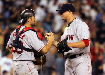 NEW YORK - JULY 03:  Jason Varitek #33 of the Boston Red Sox congratulates teammate Jon Lester #31 after Lester shutout the New York Yankees 7-0 on July 3, 2008 at Yankee Stadium in the Bronx borough of New York City.  (Photo by Jim McIsaac/Getty Images)