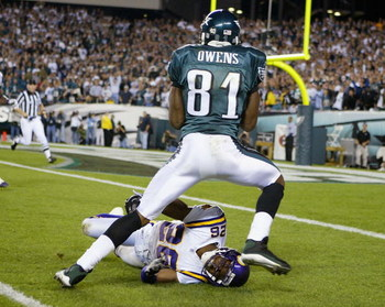 PHILADELPHIA - SEPTEMBER 20:  Terrell Owens #81 of the Philadelphia Eagles runs over Antoine Winfield #26 of the Minnesota Vikings in route to a touchdown at Lincoln Financial Field on September 20, 2004 in Philadelphia, Pennsylvania. (Photo by Ezra Shaw/