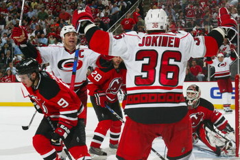 NEWARK, NJ - APRIL 28:  Jussi Jokinen #36 of the Carolina Hurricanes celebrates with teammate Rod Brind'Amour #17 of the New Jersey Devils after Joikinen scored the tying goal at 18:40 in the third period during Game Seven of the Eastern Conference Quarte