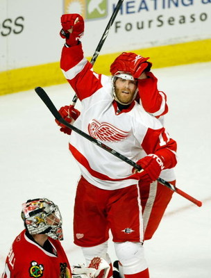 CHICAGO - MAY 22:  Dan Cleary #11 of the Detroit Red Wings celebrates with Brad Stuart #23 (obscured) after Brian Rafalski #28 scored a goal in the second period against goalie Nikolai Khabibulin #39 (L) the Chicago Blackhawks during Game Three of the Wes