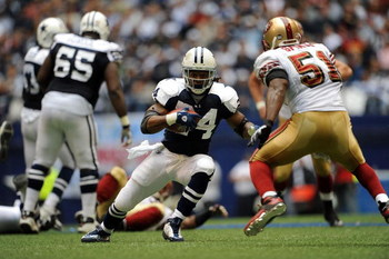 IRVING, TX - NOVEMBER 23:  Running back Marion Barber #24 of the Dallas Cowboys runs the ball against Takeo Spikes #51 of the San Francisco 49ers at Texas Stadium on November 23, 2008 in Irving, Texas.  (Photo by Ronald Martinez/Getty Images)