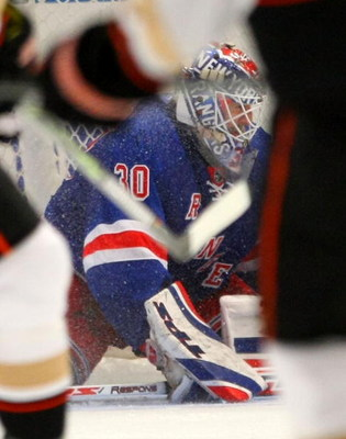 NEW YORK - JANUARY 20: Henrik Lundqvist #30 of the New York Rangers searches for the puck in a crowd against the Anaheim Ducks on January 20, 2009 at Madison Square Garden in New York City. The Rangers defeated the Ducks 4-2. (Photo by Bruce Bennett/Getty