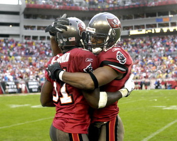 TAMPA, FL - NOVEMBER 30: Cornerback Phillip Buchanon #31 of the Tampa Bay Buccaneers celebrates an interception with safety Will Allen #26 against the New Orleans Saints at Raymond James Stadium on November 30, 2008 in Tampa, Florida.  (Photo by Al Messer