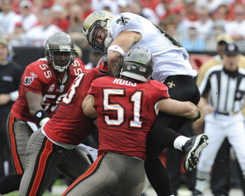 TAMPA, FL - NOVEMBER 30: Linebacker Barrett Ruud #51 of the Tampa Bay Buccaneers tackles tight end Jeremy Shockey #88 of the New Orleans Saints at Raymond James Stadium on November 30, 2008 in Tampa, Florida.  (Photo by Al Messerschmidt/Getty Images)
