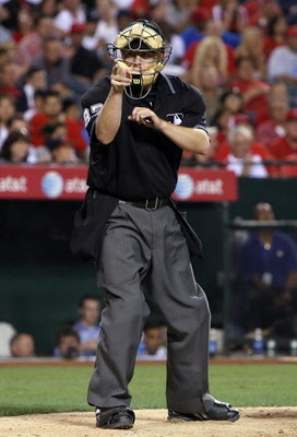 ANAHEIM, CA - AUGUST 12:  Umpire Todd Tichenor calls a strike during the game between the Seattle Mariners and the Los Angeles Angels of Anaheim at Angel Stadium on August 12, 2008 in Anaheim, California.  The Angels defeated the Mariners 7-3.  (Photo by