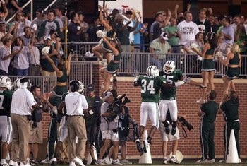 ATHENS, OH - SEPTEMBER 9:  Cornerback Dion Byrum #15 of the Ohio Bobcats celebrates his interception for a touchdown with defensive back Michael Mitchell #34 to tie the score at 7-7 against the Pittsburgh Panthers during the first quarter at Peden Stadium