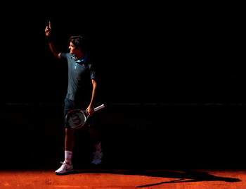 MADRID, SPAIN - MAY 17:  Roger Federer of Switzerland celebrates his win over Rafael Nadal of Spain during the final of the Madrid Open tennis tournament at the Caja Magica on May 17, 2009 in Madrid, Spain. Federer won the match in two sets, 6-4 and 6-4.
