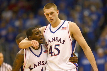 LAWRENCE, KANSAS - JANUARY 3:  Sherron Collins #4 and Cole Aldrich #45 of the Kansas Jayhawks walk on court against the Tennessee Volunteers on January 3, 2009 at Allen Fieldhouse in Lawrence, Kansas. (Photo by: Jamie Squire/Getty Images)