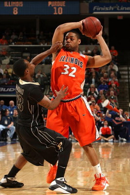 INDIANAPOLIS - MARCH 14:  Demetri McCamey #32 of the Illinois Fight Illini looks to pass the ball against Lewis Jackson #23 of the Purdue Boilermakers during their semifinal game of the Big Ten Men's Basketball Tournament at Conseco Fieldhouse on March 14