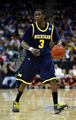 KANSAS CITY, MO - MARCH 21:  Manny Harris #3 of the Michigan Wolverines dribbles the ball against the Oklahoma Sooners during the second round of the NCAA Division I Men's Basketball Tournament at the Sprint Center on March 21, 2009 in Kansas City, Missou