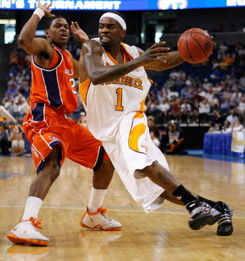 TAMPA, FL - MARCH 14:  Tyler Smith #1 of the Tennessee Volunteers drives the ball around Frankie Sullivan #20 of the Auburn Tigers during the Semifinal round of the SEC Men's Basketball Tournament on March 14, 2009 at The St. Pete Times Forum in Tampa, Fl