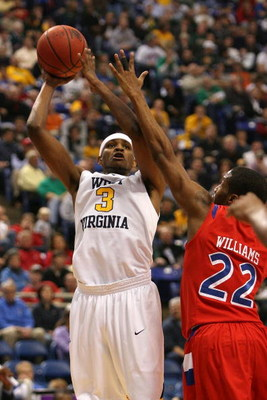 MINNEAPOLIS - MARCH 20:  Devin Ebanks #3 of the West Virginia Moutaineers attempts a shot against Paul Williams #22 of the Dayton Flyers during the first round of the NCAA Division I Men's Basketball Tournament at the Hubert H. Humphrey Metrodome on March