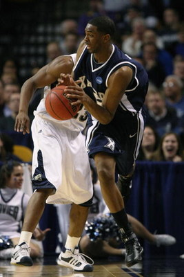 BOSTON - MARCH 26:  Sam Young #23 of the Pittsburgh Panthers and Derrick Brown #5 of the Xavier Musketeers fight to keep the ball in bounds during the NCAA Men's Basketball Tournament East Regionals at TD Banknorth Garden on March 26, 2009 in Boston, Mass