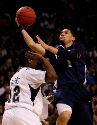 BOSTON - MARCH 28:  Scottie Reynolds #1 of the Villanova Wildcats puts up a shot over Ashton Gibbs #12 of the Pittsburgh Panthers during the NCAA Men's Basketball Tournament East Regionals at TD Banknorth Garden on March 28, 2009 in Boston, Massachusetts.