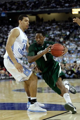 DETROIT - APRIL 06:  Kalin Lucas #1 of the Michigan State Spartans drives on Danny Green #14 of the North Carolina Tar Heels during the 2009 NCAA Division I Men's Basketball National Championship game at Ford Field on April 6, 2009 in Detroit, Michigan.