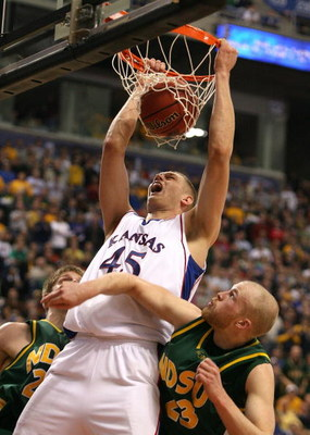 MINNEAPOLIS - MARCH 20:  Cole Aldrich #45 of the Kansas Jayhawks dunks against Michael Tveidt #23 of the North Dakota State Bison in the second half during the first round of the NCAA Division I Men's Basketball Tournament at the Hubert H. Humphrey Metrod
