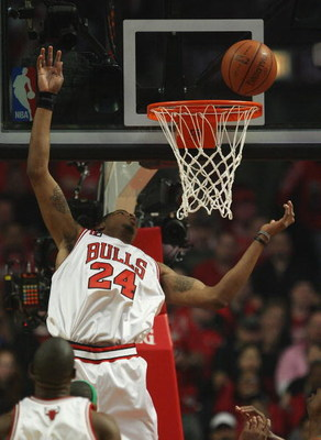CHICAGO - APRIL 26: Tyrus Thomas #24 of the Chicago Bulls tries for a rebound against the Boston Celtics in Game Four of the Eastern Conference Quarterfinals during the 2009 NBA Playoffs at the United Center on April 26, 2009 in Chicago, Illinois. The Bul
