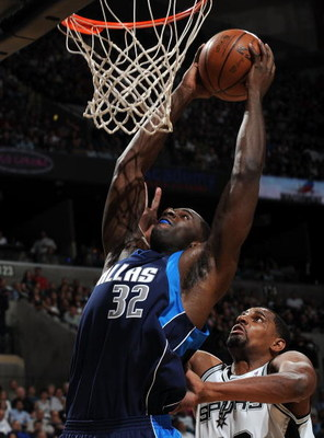 SAN ANTONIO - APRIL 28:  Forward Brandon Bass #32 of the Dallas Mavericks takes a shot against Kurt Thomas #40 of the San Antonio Spurs in Game Five of the Western Conference Quarterfinals during the 2009 NBA Playoffs at AT&T Center on April 28, 2009 in S
