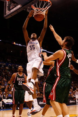OKLAHOMA CITY - OCTOBER 29:  Kevin Durant #35 of the Oklahoma City Thunder dunks the ball over Andrew Bogut #6 of the Milwaukee Bucks at the Ford Center October 29, 2008 in Oklahoma City, Oklahoma. The Bucks defeated the Thunder 98-87.  NOTE TO USER: User