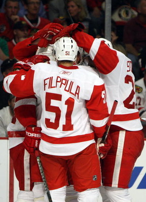 CHICAGO - MAY 22:  Valtteri Filppula #51 of the Detroit Red Wings celebrates with his teammates after Jonathan Ericcson #52 scored a goal in the second period against the Chicago Blackhawks during Game Three of the Western Conference Championship Round of