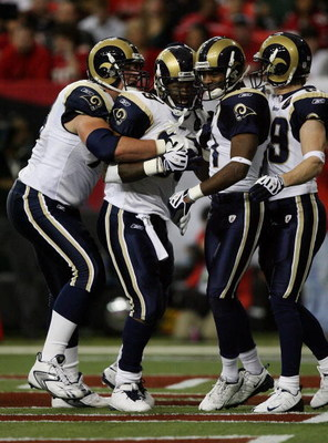 ATLANTA - DECEMBER 28:  Running back Steven Jackson #39 of the St. Louis Rams is congratulated by tackle Adam Goldberg #73, wide receivers Donnie Avery #17 and Dane Looker #89 after Jackson scored against the Atlanta Falcons at Georgia Dome on December 28