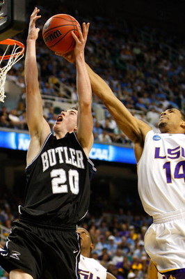 GREENSBORO, NC - MARCH 19:  Garrett Temple #14 of the Louisiana State University Tigers blocks a shot by Gordon Hayward #20 of the Butler Bulldogs during the first round of the NCAA Division I Men's Basketball Tournament at the Greensboro Coliseum on Marc