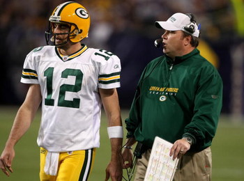 MINNEAPOLIS - NOVEMBER 09:  Quarterback Aaron Rodgers #12 and head coach Mike McCarthy of the Green Bay Packers confer against the Minnesota Vikings on November 9, 2008 at the Metrodome in Mineapolis, Minnesota.  The Vikings won 28-27.  (Photo by Stephen