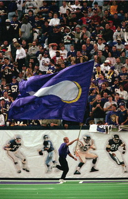 24 Oct 1999:  A banner for the Minnesota Vikings is run past the crowd during the game against San Francisco 49ers at the Metrodome in Minneapolis, Minnesota. The Vikings defeated the 49ers 40-16. Mandatory Credit: Tom Pidgeon  /Allsport