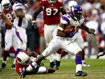 GLENDALE, AZ - DECEMBER 14:  Runningback Adrian Peterson #28 of the Minnesota Vikings breaks the tackle of Adrian Wilson #24 of the Arizona Cardinals during the game at the University of Phoenix Stadium on December 14, 2008 in Glendale, Arizona. The Vikin