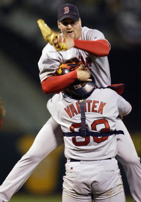 OAKLAND, CA - OCTOBER 6:  Derek Lowe #32 of the Boston Red Sox jumps into the arms of Jason Varitek #33 after the victory over the Oakland A's in game 5 of the 2003 American League Divisional Series at the Network Associates Coliseum on October 6, 2003 in