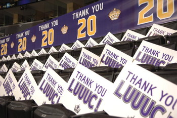 LOS ANGELES - APRIL 15:  The Los Angeles Kings organization honors Luc Robitaille #20 of the Kings with banners and 'thank you' signs for fans to hold up before his last home game with the team, against the Calgary Flames on April 15, 2006 at the Staples