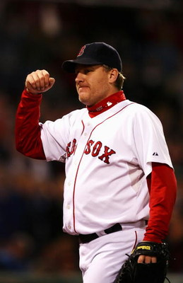 BOSTON - OCTOBER 20:  Starting pitcher Curt Schilling #38 of the Boston Red Sox smiles as he leaves the game after closing out the seventh inning against the Cleveland Indians during Game Six of the American League Championship Series at Fenway Park on Oc
