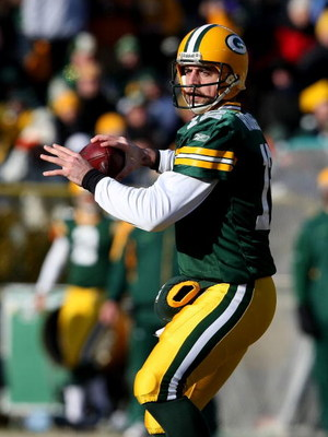 GREEN BAY, WI - DECEMBER 28: Aaron Rodgers #12 of the Green Bay Packers looks for a receiver against the Detroit Lions on December 28, 2008 at Lambeau Field in Green Bay, Wisconsin. The Packers defeated the Lions 31-21. (Photo by Jonathan Daniel/Getty Ima