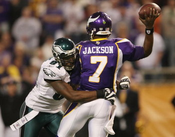 MINNEAPOLIS - JANUARY 04:   Tavaris Jackson #7 of the Minnesota Vikings is hit by Chris Clemons #91 of the Philadelphia Eagles during the NFC Wild Card playoff game on January 4, 2009 at the Hubert H. Humphrey Metrodome in Minneapolis, Minnesota. The Eagl