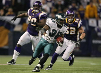 MINNEAPOLIS - JANUARY 04:   Brian Westbrook #36 of the Philadelphia Eagles carries the ball for a 71 yard touchdown as Fred Evans #90 and Chad Greenway #52 of the Minnesota Vikings defend during the NFC Wild Card playoff game on January 4, 2009 at the Hub