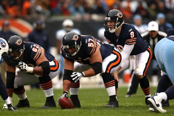 CHICAGO - NOVEMBER 09:  Rex Grossman #8 of the Chicago Bears stand under center Olin Kreutz #57 as he calls out signals at the line of scrimmage against the Tennessee Titans at Soldier Field on November 9, 2008 in Chicago, Illinois.  (Photo by Jonathan Fe