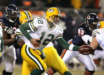 CHICAGO - DECEMBER 22: Aaron Rodgers #12 of the Green Bay Packers turns to hand off against the Chicago Bears on December 22, 2008 at Soldier Field in Chicago, Illinois. The Bears defeated the Packers 20-17 in overtime. (Photo by Jonathan Daniel/Getty Ima