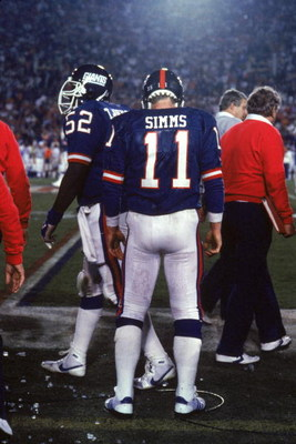 PASADENA, CA - JANUARY 25:  Quarterback Phil Simms #11 of the New York Giants stands on the sideline against the Denver Broncos during Super Bowl XXI at the Rose Bowl on January 25, 1987 in Pasadena, California. The Giants defeated the Broncos 39-20. (Pho