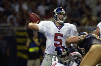 ST.LOUIS - SEPTEMBER 15:  Quarterback Kerry Collins #5 of the New York Giants prepares to throw in the second quarter against the St. Louis Rams  on September 15, 2002 at the Edward Jones Dome in St. Louis, Missouri. (Photo by Mary Butkus/Getty Images)