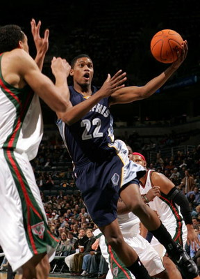 MILWAUKEE - DECEMBER 08:  Rudy Gay #22 of the Memphis Grizzlies drives for a shot attempt against Dan Gadzuric #50 of the Milwaukee Bucks December 8, 2006 at the Bradley Center in Milwaukee, Wisconsin. NOTE TO USER: User expressly acknowledges and agrees