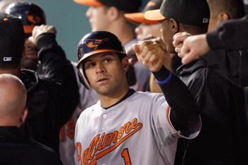 KANSAS CITY - MAY 14:  Brian Roberts #1 of the Baltimore Orioles celebrates in the dugout against the Kansas City Royals on May 14, 2009 at Kauffman Stadium in Kansas City, Missouri. (Photo by: Jamie Squire/Getty Images)