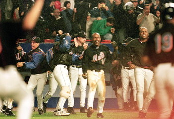 17 Oct 1999:  The New York Mets celebrate during the NLCS game four against the Atlanta Braves at Shea Stadium in Flushing, New York. The Mets defeated the Braves 4-3. Mandatory Credit: Jamie Squire  /Allsport